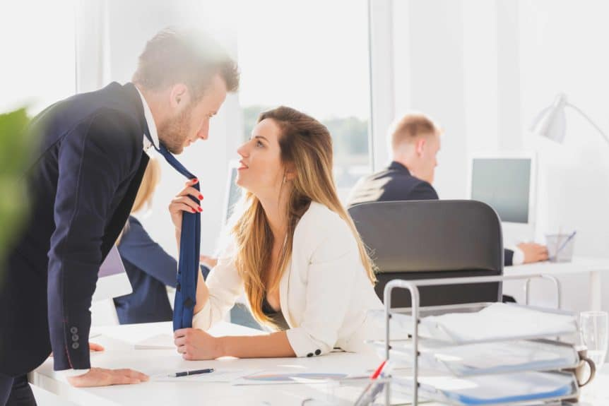 What Are the Pros & Cons of Dating a Co-Worker?